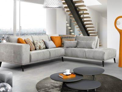 Canapé assise et accoudoirs capitonnés qui peut être personnalisé, notamment par le coloris, la configuration et le piétement bois ou métal