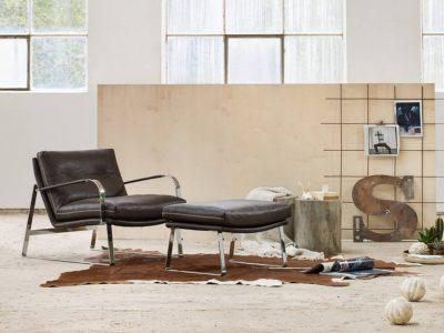 Ce fauteuil structure métal, du designer Lenka Teilmann, existe en cuir mais aussi en tissu et dans un grand choix de coloris